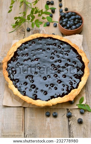 Homemade blueberry pie on wooden table, top view - stock photo