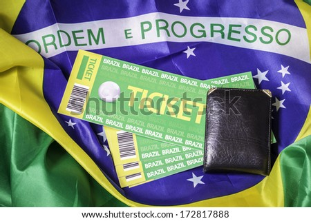 Homemade brazilian tickets 2014 on the brazilian flag on the background - stock photo