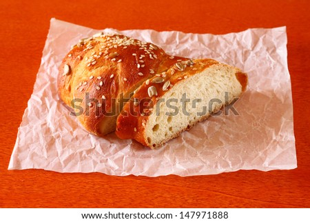 homemade bread  in baking paper on wooden table, selective focus