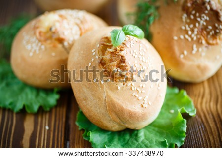 homemade bread loaf with cheese inside and sesame seeds - stock photo