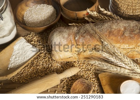 Homemade bread, wheat and kitchen utensils