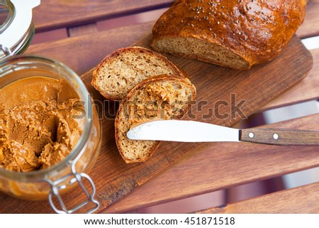 homemade bread with nut paste on a wooden table