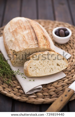 Homemade bread with olives and thyme