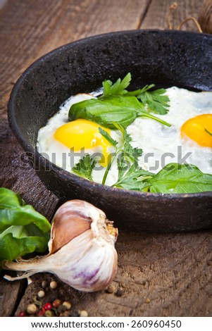 Homemade breakfast with Fried eggs on pan - stock photo