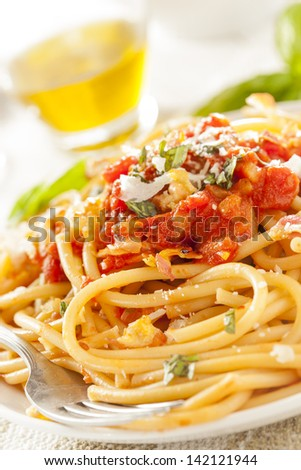 Homemade Bucatini Amatriciana Pasta with sauce and basil