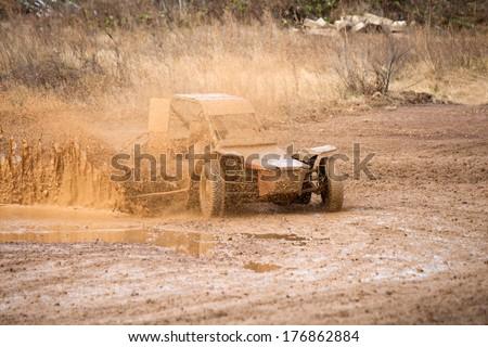 Homemade buggies racing on the dirt track - stock photo