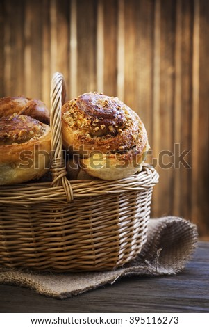 homemade bun in a basket on a wooden table