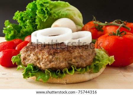 homemade burger with white onion and tomato - stock photo