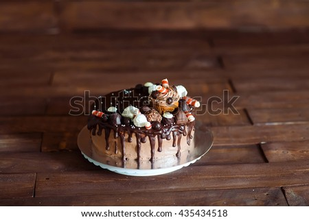 homemade cake decorated with sweets, cupcakes and waffles. - stock photo