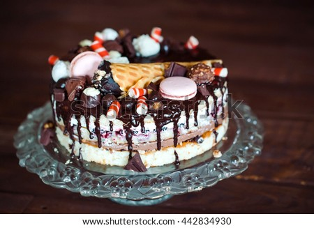 homemade cake decorated with sweets, macaroon and waffles. - stock photo