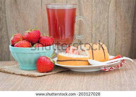 Homemade cake roll with strawberry cream and fresh strawberry - stock photo