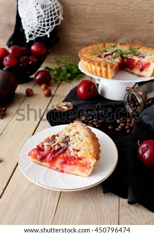 Homemade cake with plums and cream filling