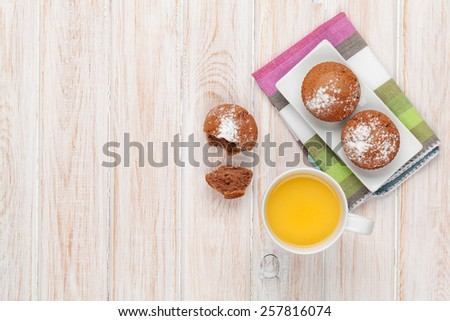 Homemade cakes and orange juice on white wooden table. Top view with copy space - stock photo