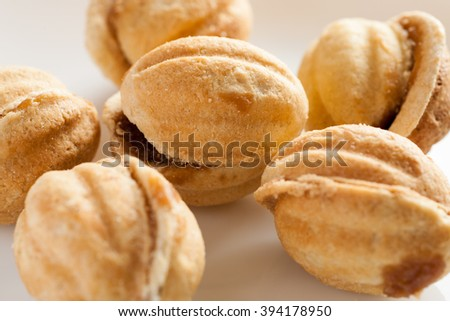 Homemade cakes in shape of nut with condensed milk, closeup shot, selective focus - stock photo