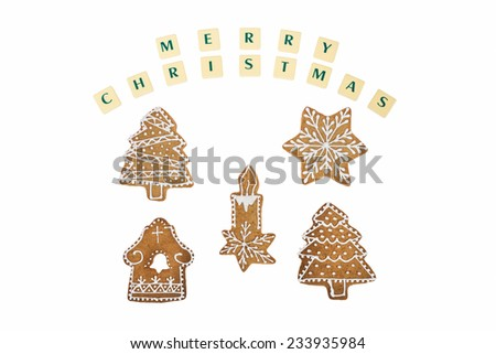 Homemade candle,christmas trees, star and house in decoration gingerbread and honey cookies on nice christmas theme with a wishes on white background. - stock photo