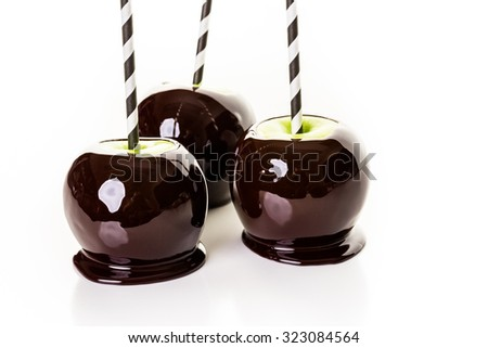 Homemade candy apples on a white background.