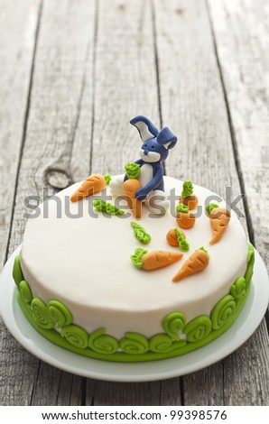 Homemade carrot cake with rabbit decoration on old wood table