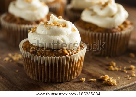 Homemade Carrot Cupcakes with Cream Cheese Frosting for Easter - stock photo