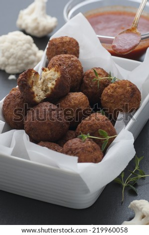 Homemade cauliflower falafel served with spicy tomato sauce. - stock photo