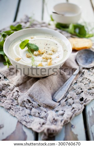 Homemade cauliflower soup with peas - stock photo