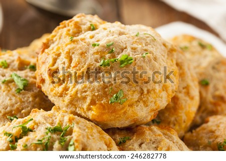 Homemade Cheddar Cheese Biscuits with Parsley - stock photo