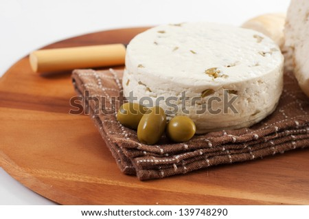 homemade chees with olives against white background