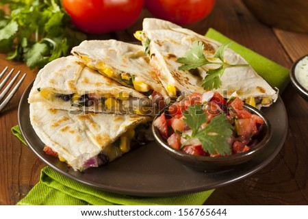 Homemade Cheese and Bean Quesadilla with Corn and Salsa - stock photo