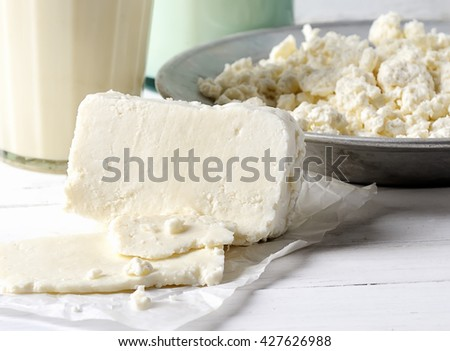 homemade  cheese,milk and cottage cheese on a wooden background.rustic style