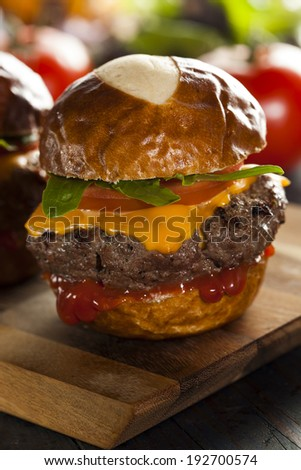 Homemade Cheeseburger Sliders with Lettuce Tomato and Cheese - stock photo