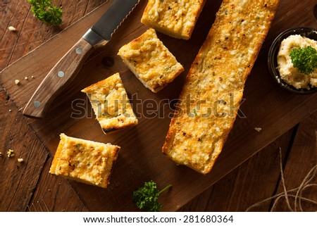 Homemade Cheesy Garlic Bread with Herbs and Spices - stock photo