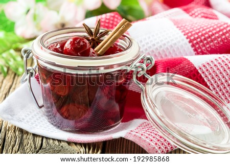 Homemade cherry jam on wooden background - stock photo