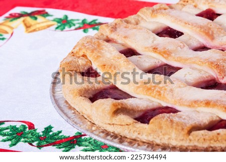 Homemade cherry pie with lattice crust christmas or thanksgiving holiday theme - stock photo