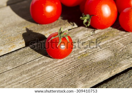 homemade cherry tomatoes loose on the old wooden background Stock Image
