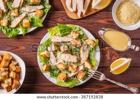 Homemade Chicken Caesar Salad with Cheese and Croutons, top view. - stock photo