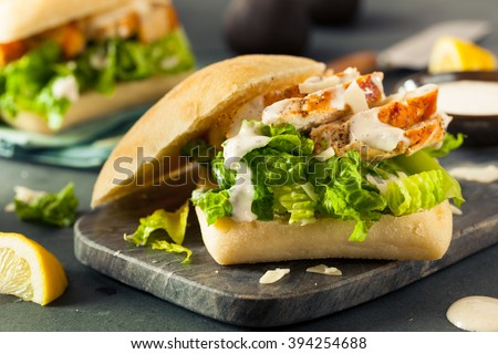 Homemade Chicken Caesar Sandwich with Cheese and Lemon - stock photo