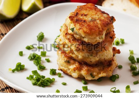 Homemade chicken cutlets sprinkled with green onion, selective focus