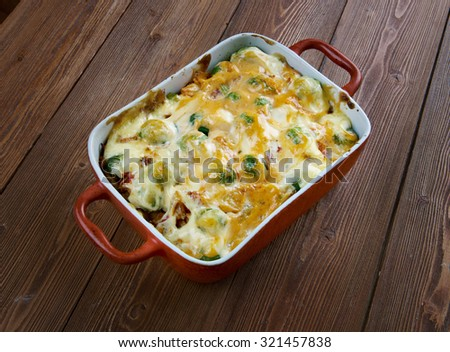 Homemade Chicken Divan - chicken casserole served with almonds, and Mornay sauce.  American cuisine  - stock photo