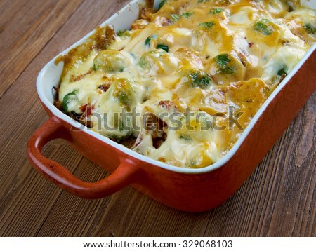 Homemade Chicken Divan - chicken casserole served with almonds, and Mornay sauce.  American cuisine