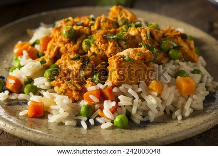 Homemade Chicken Tikka Masala with Rice and Naan - stock photo