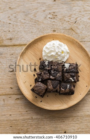 homemade chocolate brownies on wood table, top view - stock photo