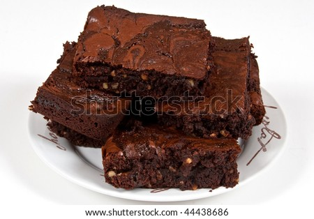 Homemade chocolate brownies with nuts and caramel on a plate
