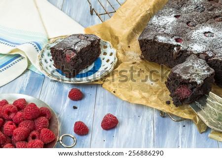 Homemade chocolate brownies with raspberries - stock photo