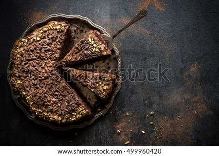 Homemade chocolate cake served on metal plate,blank space