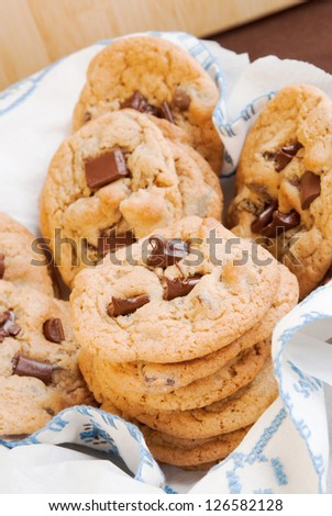 homemade chocolate chip cookies on a white and blue stitched napkin