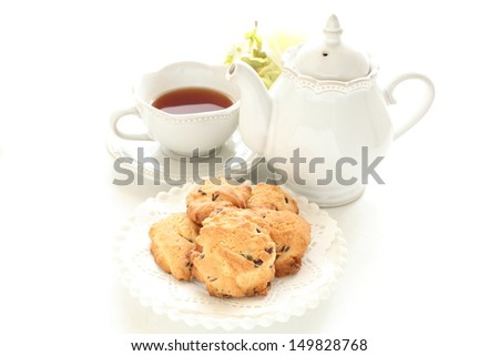 Homemade chocolate chips cookie and English tea