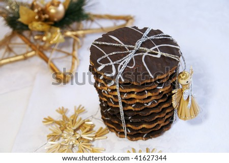 Homemade chocolate cookies for Christmas and New Year gift, arranged with festive decoration - stock photo