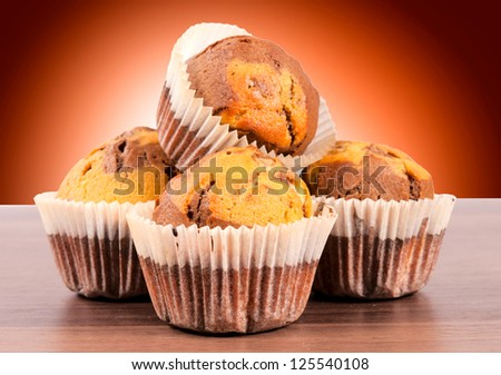 Homemade chocolate cup cake on wooden table - stock photo