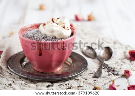 Homemade chocolate mug cake with icing sugar