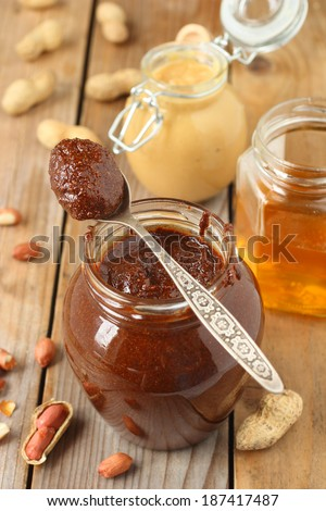 Homemade chocolate peanut butter in glass jar