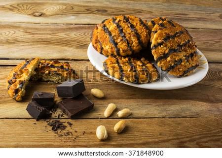 Homemade chocolate peanut cookies on a plate. Cookies. Pastry. Biscuits. Homemade cookies - stock photo